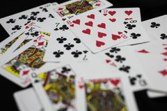 Splattered Playing Cards. A deck of playing cards splattered over the table Royalty Free Stock Photography