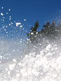 Splattered snow and blue sky,ski time. Splattered snow by a skier Stock Images