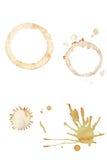 Splatters del caffè ed anelli della tazza Fotografia Stock