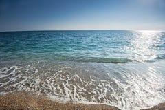 Splatters den sandiga stranden royaltyfri foto