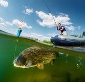 Spleet van de visser wordt geschoten die Royalty-vrije Stock Afbeeldingen