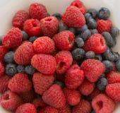 Splendid Arrrangement of Raspberries and Blueberries Royalty Free Stock Photography