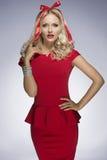 Splendid blonde girl adorned with xmas ribbon Stock Photo