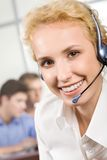 Splendid consultant. Portrait of nice smiling consultant with headset Royalty Free Stock Images