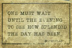 Splendid day Sophocles. One must wait until the evening - ancient Greek philosopher Sophocles quote printed on grunge vintage cardboard Stock Photography