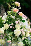 Splendid fresh bouquet. Splendid bouquet of beautiful natural fresh creamy white and pink roses with green leaves floral decor background Stock Photography