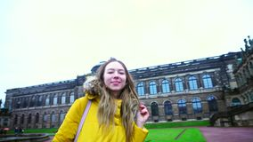 Splendid girl walks through palace and park complex and admires beauty of outdoors in daytime Dresden. stock video