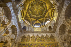 Splendid interior decoration of the Mezquita in Cordoba, Spain. Splendid interior decoratin of the Mihrab (praying chamber) in the Mezquita (Mosque-converted Stock Images