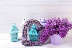 Splendid lilac flowers, heart   and lanterns  with candles on wh Stock Images