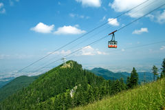 Splendid mountain view - cable cabin and sky Stock Photos