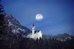 Splendid night scene of royal castle Neuschwanstein and surrounding area in Bavaria, Germany Deutschland. Famous Bavarian destination sign at snowy winter Stock Images