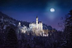 Splendid night scene of royal castle Neuschwanstein and surrounding area in Bavaria, Germany Deutschland. Famous Bavarian destination sign at snowy winter Stock Photos