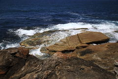 Splendid rocks stroked by wave. Splendid colourful rocks stroked by white waves Stock Photos