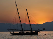 Splendid sailboat at sunset Stock Images