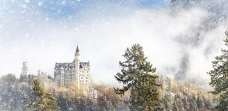Splendid scene of royal castle Neuschwanstein and surrounding area in Bavaria, Germany Deutschland. Famous Bavarian destination sign at sunny snowy winter day stock photos