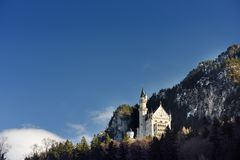 Splendid scene of royal castle Neuschwanstein and surrounding area in Bavaria, Germany Deutschland. Famous Bavarian destination sign at sunny snowy winter day stock images