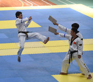 Splendid show of contestants with black belt --The seventh GoldenTeam Cup Taekwondo friendly competition Royalty Free Stock Images