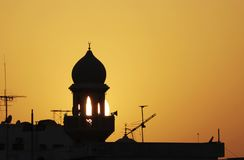Splendid silhouette of a mosque minaret during sunset Royalty Free Stock Images