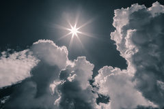 Splendid stunning amazing view of dark dramatic monochrome sky, clouds and bright sun background Royalty Free Stock Images