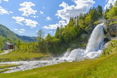 Splendid summer view with popular waterfall Steinsdalsfossen on Royalty Free Stock Photo