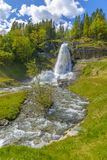 Splendid summer view with popular waterfall Steinsdalsfossen on Royalty Free Stock Images