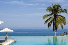 Splendid swimming pool in a hotel resort Royalty Free Stock Photography