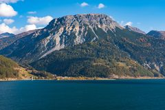 Beautiful view to Lago di Resia, Lake Reschen, Alto Adige, South Tyrol, Italy. Splendid view of lake Resia - Reschensee - South Tyro, Italy, Europe royalty free stock photo