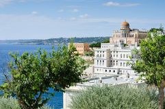 Splendid villa on the Italian coast. View of a eastern style villa and some white houses on the southern coast of Italy. Santa Cesarea Terme Royalty Free Stock Photography