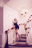 Splendid woman on staircase. Splendid young woman on staircase Stock Image