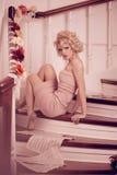 Splendid woman on staircase Stock Photo