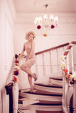 Splendid woman on staircase. Splendid young woman on staircase Royalty Free Stock Photography