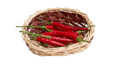 Splendid, wooden basket full of red peppers Stock Image