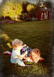 Splendor in the Grass. Young Girl and Boy Playing in a backyard Royalty Free Stock Photography