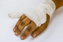 Splint finger a broken bone with a bandage Stock Photo