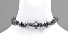 Splintered hematite chain on bust Royalty Free Stock Images