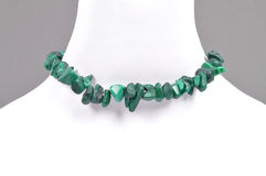 Splintered malachite chain on bust Royalty Free Stock Photography