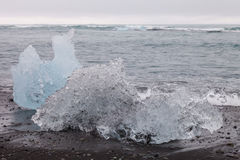 Splinters of ice from Iceberg lagoon jokulsarlon on the sea coas Royalty Free Stock Photography