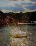 Splish Splash. Throwing rocks in the water to make a splash Stock Photo