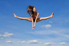 Split in the air. Girl jump high up in the air Royalty Free Stock Images