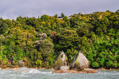 Split apple rock in Abel Tasman National Park, New Zealand Royalty Free Stock Photography