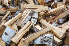 Split birch firewood. Texture with a stab birch wood. Firewood randomly scattered across the frame Stock Photos