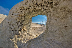 Split cathedral tower in stone hole Stock Image
