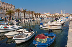 Split City, boats in Harbor and the Diocletian Palace in the bac Stock Photo