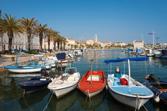Split city`s harbor with colorful boats and the Diocletian Palac Royalty Free Stock Photo