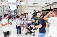 Grupa TV crew working on the street stock image