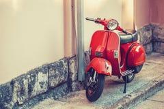 SPLIT, CROATIA - JULY 09, 2017: Red vintage scooter parked near a building wall - outdoors shot - Split, Croatia. SPLIT, CROATIA - JULY 09, 2017: Red vintage Royalty Free Stock Photo