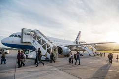 SPLIT, CROATIA - MARCH 6, 2015: Passengers exiting Croatia Airlines' Airbus A320 parked on a runway of Split Airport Royalty Free Stock Photos