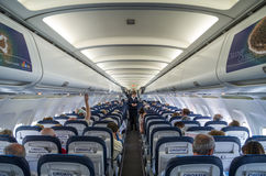 SPLIT, CROATIA - MARCH 6, 2015: Passengers inside of Croatia Airlines' Airbus A320 during pre-flight safety demonstration. stock photo