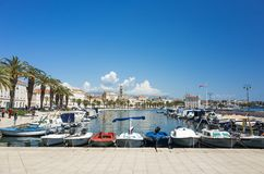 Harbor with boats and blue sky in Split Croatia Europe. Split, Croatia, May 21 2018, Beautiful sunny day in the old town, Nice outdoors of the popular tourist Royalty Free Stock Photo