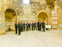Split, Croatia - May 08, 2014: The male choir singing in the Old City on a cloudy summer day Stock Image